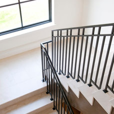 Contemporary Staircase by TATUM BROWN CUSTOM HOMES