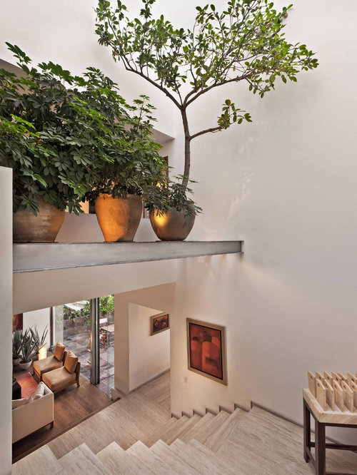 high vaulted ceiling lighting ideas - Foyer Plant Ledge Decorating