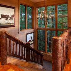 Rustic Staircase by Morgan-Keefe Builders, Inc.
