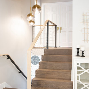 Inspiration for a transitional wooden u-shaped cable railing staircase remodel in San Francisco
