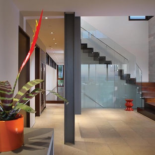 Minimalist wooden l-shaped glass railing staircase photo in Orange County with wooden risers