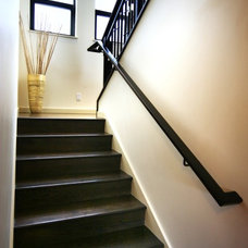 Modern Staircase by Blue Sound Construction, Inc.