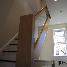 Modern Staircase by Fox Woodworking, LLC