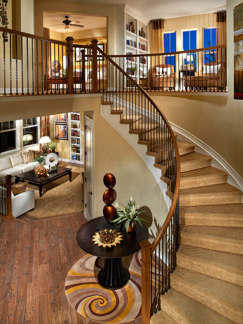 elegant carpeted curved staircase photo in denver