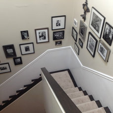 Traditional Staircase by Charles & Edward Inc.
