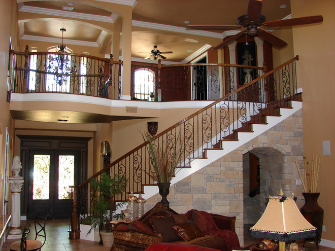 Mediterranean Staircase by Summit Country Homes & Remodeling