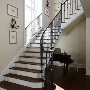 Example of a classic wooden l-shaped staircase design in Jacksonville with painted risers