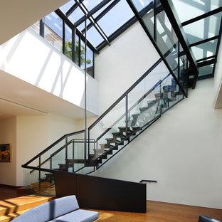 Ejemplo de escalera en U, actual, extra grande, sin contrahuella, con escalones de vidrio