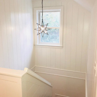 Small transitional wooden u-shaped wood railing staircase photo in Charleston with wooden risers