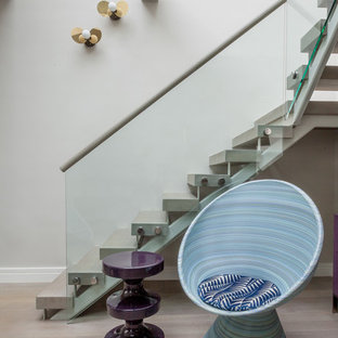 Mid-sized trendy wooden u-shaped open and glass railing staircase photo in New York