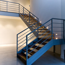 Contemporary Staircase by reVISION Custom Home Renovations Inc.