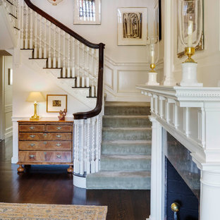 Staircase - mid-sized traditional carpeted u-shaped wood railing staircase idea in Boston with carpeted risers
