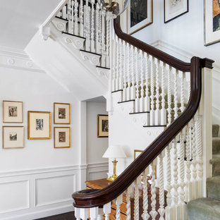 Example of a mid-sized classic carpeted u-shaped wood railing staircase design in Boston