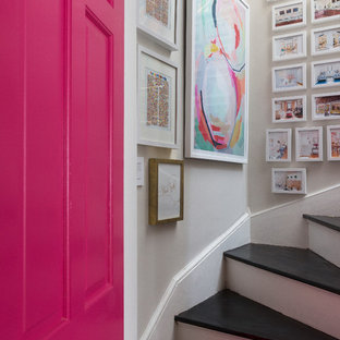 Inspiration for a mid-sized transitional wooden curved staircase remodel in Boston with painted risers