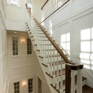 Large transitional wooden u-shaped wood railing staircase photo in Chicago with painted risers
