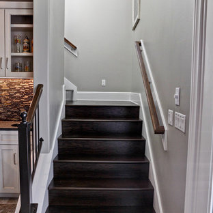 Example of a small transitional wooden l-shaped wood railing staircase design in Austin with wooden risers