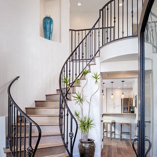 Inspiration for a large mediterranean wooden curved staircase remodel in San Diego with wooden risers