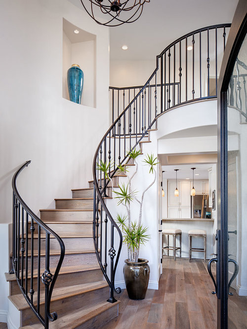 Design Ideas For A Large Mediterranean Wood Curved Staircase In San Diego  With Wood Risers.