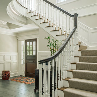 Mid-sized elegant wooden l-shaped wood railing staircase photo in Boston with painted risers