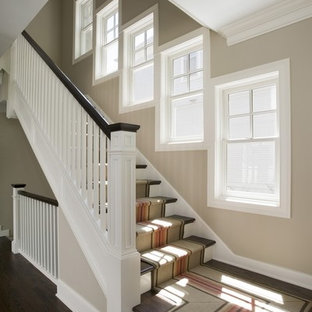 Inspiration for a mid-sized timeless wooden l-shaped staircase remodel in Chicago with painted risers
