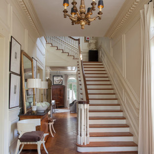 Elegant wooden l-shaped staircase photo in New Orleans with painted risers