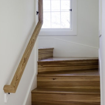 Clean Wrapping Staircase with Built-ins
