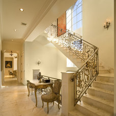 Mediterranean Staircase by Clifford M. Scholz Architects Inc.