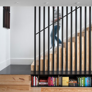 Staircase - scandinavian wooden l-shaped staircase idea in Austin with wooden risers
