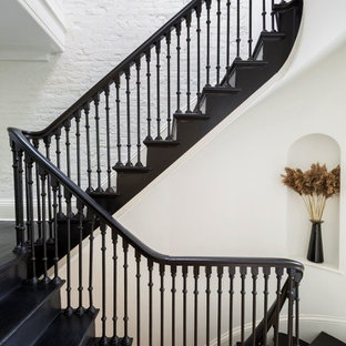 Example of a transitional painted u-shaped staircase design in New York with painted risers