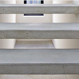 Imagen de escalera suspendida, contemporánea, grande, sin contrahuella, con escalones de hormigón