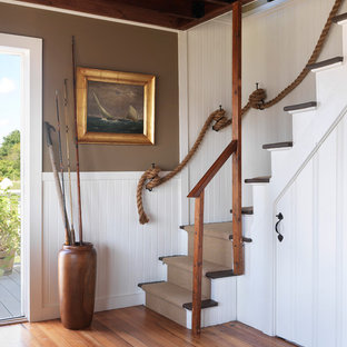 Inspiration for a coastal wooden l-shaped staircase remodel in Providence