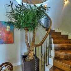 Mediterranean Staircase by Adam Wilson Custom Homes