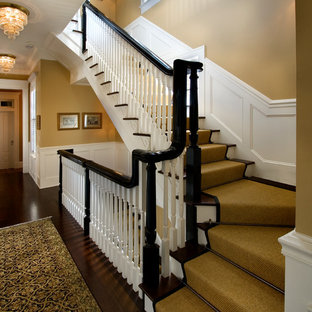 Staircase - large traditional carpeted straight wood railing staircase idea in Orlando with wooden risers