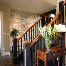 Traditional Staircase by Geometra Design Ltd.