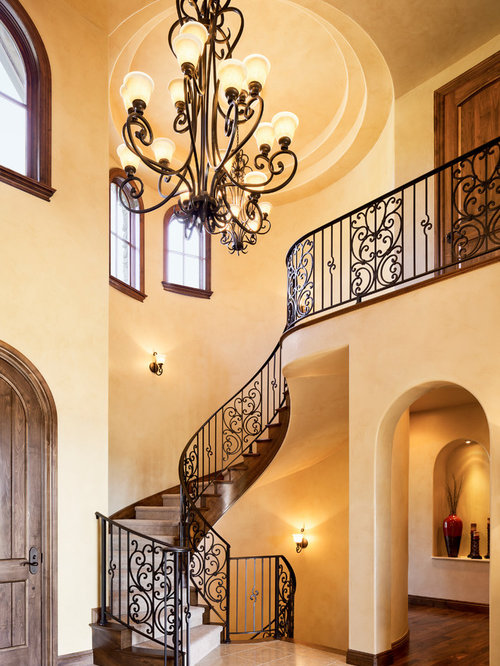 Inspiration For A Mediterranean Foyer Remodel In Denver With Beige Walls, A  Single Front Door
