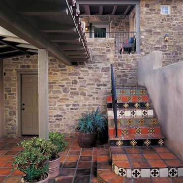 Colorful Tile Staircase with Rustic Stone and Mediterranean Feel