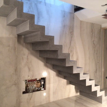Coloured, polished concrete, stepped soffit stairs