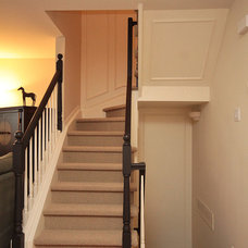Transitional Staircase by Menage Interiors