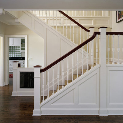 Elegant wooden staircase photo in Seattle
