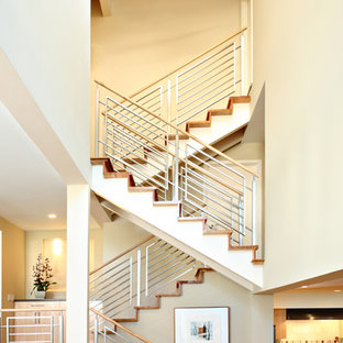 Trendy wooden u-shaped staircase photo in Los Angeles