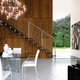 Ejemplo de escalera recta, actual, grande, sin contrahuella, con escalones de acrílico