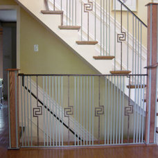 Contemporary Staircase by BO CREATIVE STEEL INC.