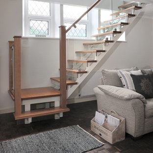 Example of a mid-sized trendy wooden l-shaped wood railing staircase design in Other with glass risers
