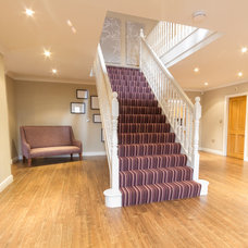 Traditional Staircase by Furnished by Anna