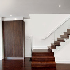 Modern Staircase by Arnal Photography