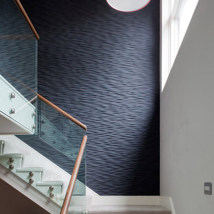 Design ideas for a contemporary painted wood staircase in Cornwall with painted wood risers.