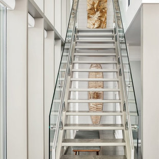 Example Of A Trendy Straight Open And Glass Railing Staircase Design In New  Orleans