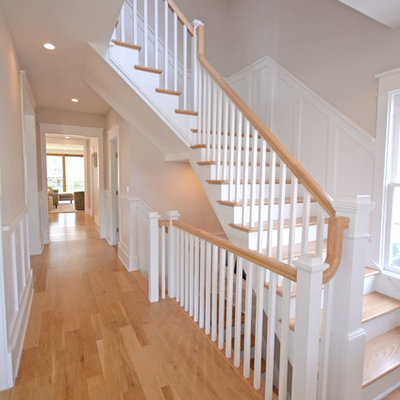 Mid-sized country wooden l-shaped wood railing staircase photo in DC Metro with painted risers