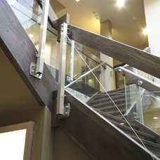 Contemporary Staircase by Amber Stairs & Railings Inc.