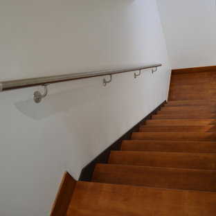 Large trendy wooden floating open staircase photo in San Diego